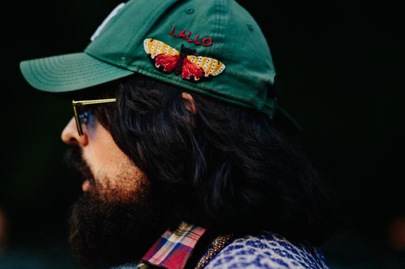 Closeup of man in green cap